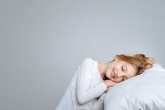 Delighted cute girl pretending to sleep Royalty Free Stock Image