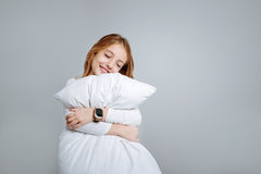 Delighted cute little girl embracing pillow. My dear. Positive delighted little girl holdign pillow and embracing it while going to sleep Stock Photography