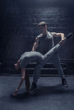 Delighted dancers performing in close interaction with each other Stock Photos