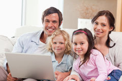Delighted family using a laptop Royalty Free Stock Images