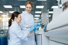 Delighted female lab assistants expressing positivity Stock Photos