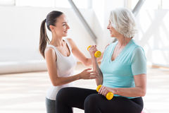 Delighted fitness coach looking at the woman Royalty Free Stock Image