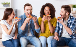 Delighted friends eating pizza Royalty Free Stock Photo