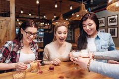 Delighted friends taking bocals with beer Royalty Free Stock Photos