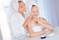 Delighted girl being glad of beauty procedure Stock Photos