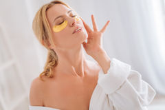 Delighted girl enjoying her face procedure Stock Photo