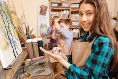 Delighted girl enjoying painting in the art studio Royalty Free Stock Photos