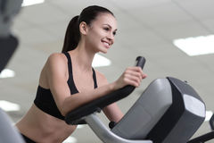 Delighted girl training on a treadmill. Royalty Free Stock Images