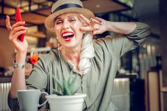 Delighted good looking woman showing her positive emotions royalty free stock photos