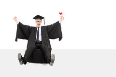 Delighted graduate holding a diploma Stock Image