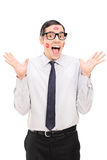 Delighted guy covered in lipstick kisses Royalty Free Stock Photography