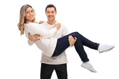 Delighted guy holding a girl in his arms Stock Image