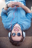 Delighted guy listening to music Royalty Free Stock Photo