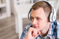 Delighted guy listening to music Royalty Free Stock Photos