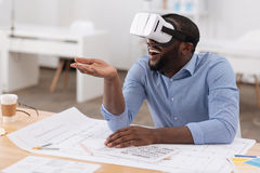 Delighted handsome man testing 3d glasses Royalty Free Stock Images