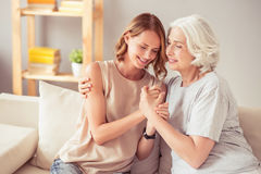 Delighted happy woman and her grandmother embracing Royalty Free Stock Images