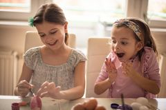 She delighted with her sister`s creativity for Easter royalty free stock photography