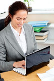 Delighted hispanic businesswoman working Stock Photo