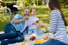 Delighted invalid man spending time on the picnic Stock Photos