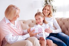 Delighted joyful girl receiving a gift Stock Images