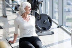 Delighted joyful senior woman relaxing in the gym. Stock Images