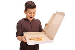 Delighted little boy looking at a pizza box Stock Photo