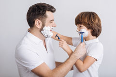 Delighted man and boy going to shave Stock Photography