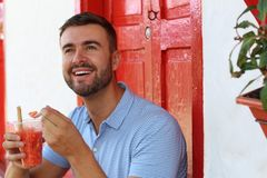 Delighted man eating a Colombian `Salpicon` royalty free stock images