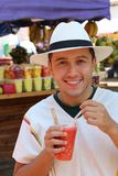 Delighted man eating a Colombian `Salpicon`.  stock photo