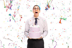 Delighted man holding a birthday cake Stock Image