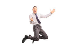 Delighted man jumping and gesturing success. Full length portrait of a delighted businessman jumping and gesturing success shot in mid-air isolated on white stock photo