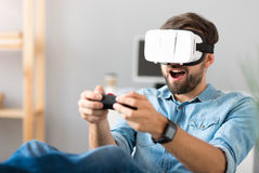 Delighted man playing video games Royalty Free Stock Photos