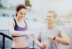 Delighted man and woman waiting for their outdoor training Stock Photo