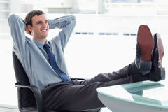 Delighted manager relaxing Royalty Free Stock Photo