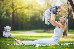 Delighted mother with her son outdoors in a park Royalty Free Stock Photography