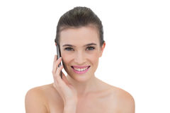 Delighted natural brown haired model making a phone call Royalty Free Stock Images