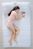 Delighted nice woman holding the alarm clock Royalty Free Stock Images
