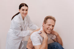 Delighted patient having his spine treated by expert Stock Images