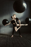 Delighted pleasant ballet dancers performing in the studio Royalty Free Stock Images