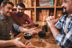 Delighted positive friends enjoying their night out Stock Image