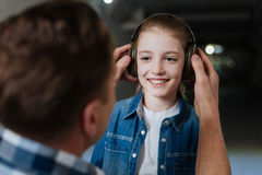 Delighted positive girl getting ready for shooting Stock Photography