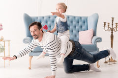 Delighted positive man being on all fours Royalty Free Stock Images