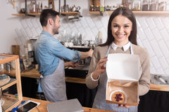 Delighted positive waiters preparing order. Royalty Free Stock Image