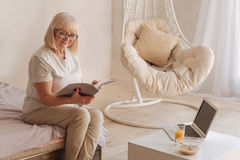 Delighted positive woman reading a magazine Stock Photography