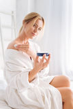 Delighted pretty female posing on camera Royalty Free Stock Images