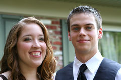 Delighted Prom Couple. Closeup horizontal portrait of a smiling teen multiracial couple in prom attire, taken in an outdoor setting.  (Shallow depth of field Stock Images