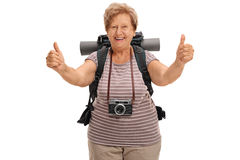 Delighted senior hiker giving two thumbs up Royalty Free Stock Image