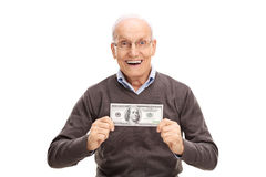 Delighted senior holding a hundred dollar bill. Delighted senior gentleman holding a hundred dollar bill and smiling isolated on white background Royalty Free Stock Photos