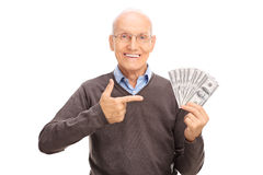 Delighted senior holding a stack of money Royalty Free Stock Photography