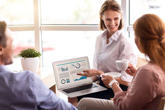 Delighted smiling woman holding laptop Royalty Free Stock Photo